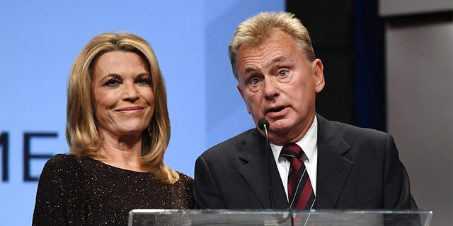 Vanna White (L) and host Pat Sajak.