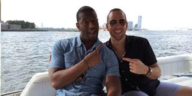 Gillum poses with Adam Corey on the yacht. (Courtesy Christopher Kise)