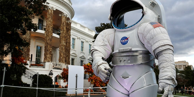 A space suit from NASA on display among the decorations on the South Portico of the White House decorated for Halloween.