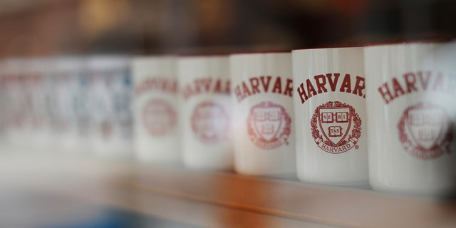 Mugs bearing the school's logo are displayed for sale outside Harvard University in Cambridge Massachusetts U.S