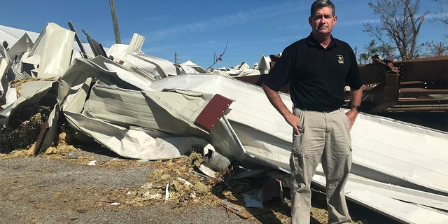 Panama City manager Mark McQueen standing near an area destroyed by Hurricane Michael in Panama City, Fla. The retired two-star general started his new job two weeks before the storm. (AP Photo/Tamara Lush)