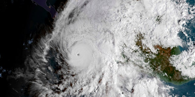This GOES East satellite image provided by NOAA shows Hurricane Willa in the eastern Pacific, on a path toward Mexico's Pacific coast on Monday, Oct. 22, 2018. (NOAA via AP)
