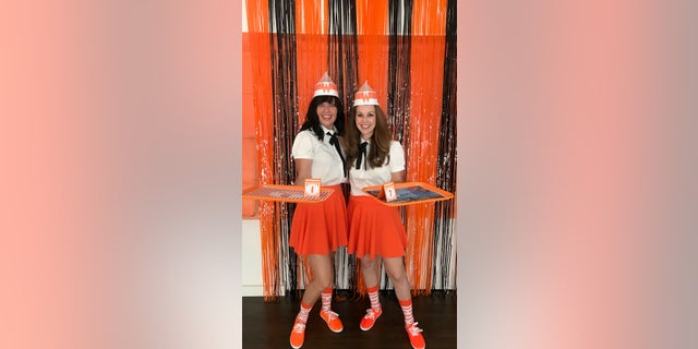 """Nicole Jensen and Cheri Horner actually used official Whataburger signage for their """"Whataween"""" party."""