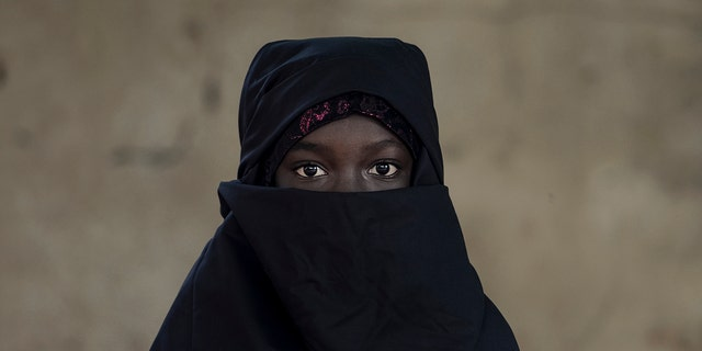 "Few women in Algeria wear the niqab because the hijab, a scarf that covers the head and neck but not the face, is far more popular.<br data-cke-eol=""1"">"