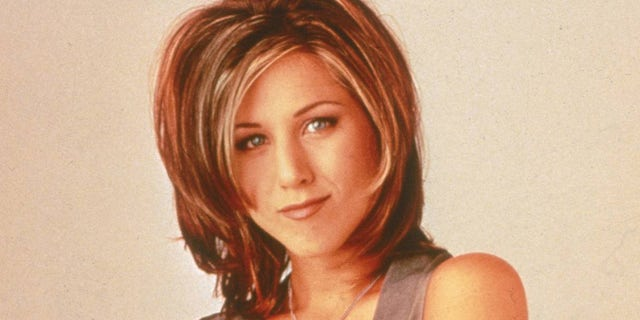 "Jennifer Aniston with ""The Rachel"" hairstyle. Aniston played Rachel Green on the NBC sitcom ""Friends."""