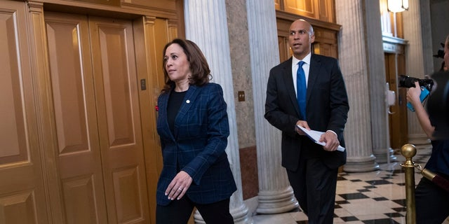 Senate Judiciary Committee members Sen. Kamala Harris, D-Calif., left, and Sen. Cory Booker, D-N.J., arrive at the chamber for the final vote to confirm Supreme Court nominee Brett Kavanaugh, at the Capitol in Washington.