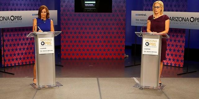 U.S. Senate candidates, U.S. Rep. Martha McSally, R-Ariz., left, and U.S. Rep. Kyrsten Sinema, D-Ariz., prepare their remarks in a television studio prior to a televised debate.