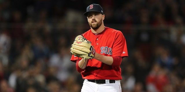 Pitcher Heath Hembree #37 of the Boston Red Sox reacts after a double ends the eighth inning of Game Two of the American League Division Series against the New York Yankees at Fenway Park.