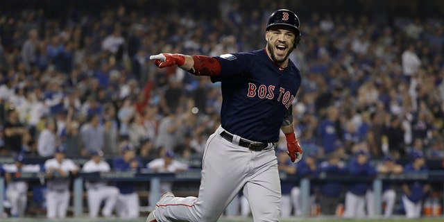 Boston Red Sox's Steve Pearce celebrates his second home run during the eighth inning in Game 5 of the World Series baseball game against the Los Angeles Dodgers on Sunday, Oct. 28, 2018, in Los Angeles.