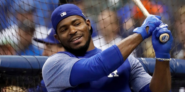 Los Angeles Dodgers' Yasiel Puig takes batting practice before Game 6 of the National League Championship Series baseball game against the Milwaukee Brewers Friday, Oct. 19, 2018, in Milwaukee.