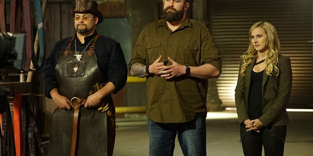 """Trent, Zeke and Ashley address contestants on Discovery's """"Master of Arms.'"""