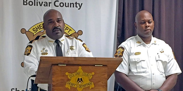 Bolivar County Sheriff Kelvin Williams, left, speaks to reporters at a news conference Tuesday in Shaw, Miss., concerning a 20-month-old girl discovered dead in an oven. Accompanying the sheriff is Chief Deputy Gerald Wesley Jr. (Leah Allen /The Bolivar Commercial via AP)