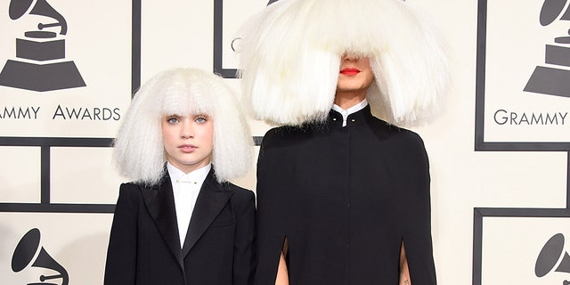Dancer Maddie Ziegler (L) and singer/songwriter Sia attended the 57th Annual Grammy Awards in 2015. (Photo by Jeff Vespa/WireImage)
