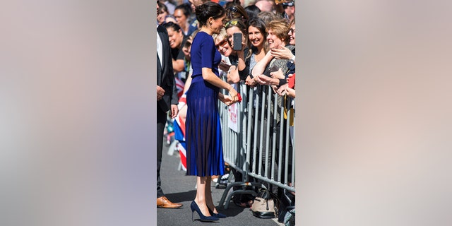 The Duchess of Sussex meets members of the public during a walkabout in Rotorua in Rotorua, New Zealand, Wednesday, Oct. 31, 2018. (Dominic Lipinski/Pool Photo via AP)