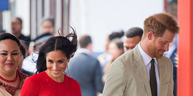 Britain's Prince Harry and Meghan, Duchess of Sussex arrive at Fua'amotu Airport in Tonga, Thursday, Oct. 25, 2018. Prince Harry and his wife Meghan are on day 10 of their 16-day tour of Australia and the South Pacific. (Dominic Lipinski/Pool Photo via AP)
