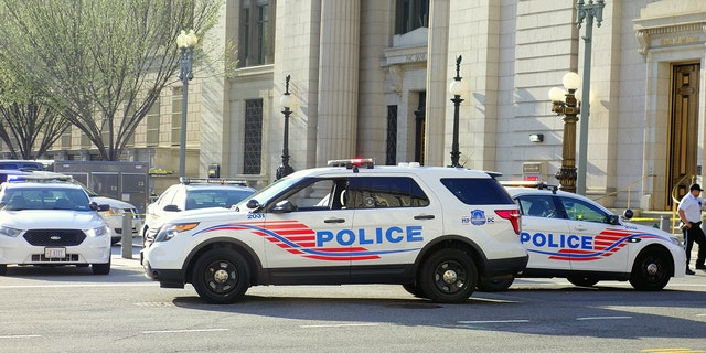 Washington DC, USA - April 12, 2015: Police vehicles stopping the traffic and closing a street in Washington DC (iStock)