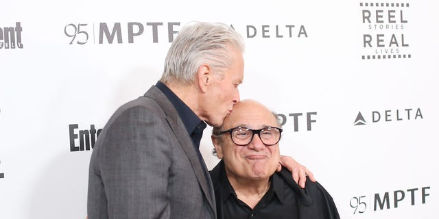 Michael Douglas, left, and Danny DeVito arrive at the 5th Annual Reel Stories, Real Lives Benefiting MPTF held at Milk Studios on April 7, 2016 in Los Angeles, California. (Photo by Michael Tran/FilmMagic)