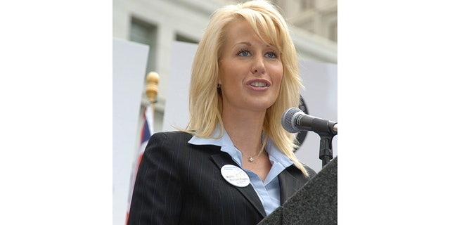 Michelle LeClair speaking at a Scientology event.