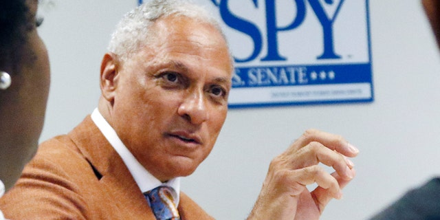 In this Oct. 5, 2018 photograph, Mike Espy, a former congressman and former U.S. agriculture secretary, speaks to college and high school students in a small forum on education in Jackson, Miss. Espy hopes to unseat appointed U.S. Sen. Cindy Hyde-Smith, R-Miss., and serve the last two years of the six-year term vacated when Republican Thad Cochran retired for health reasons. There are two other opponents in the non-partisan race. (AP Photo/Rogelio V. Solis)