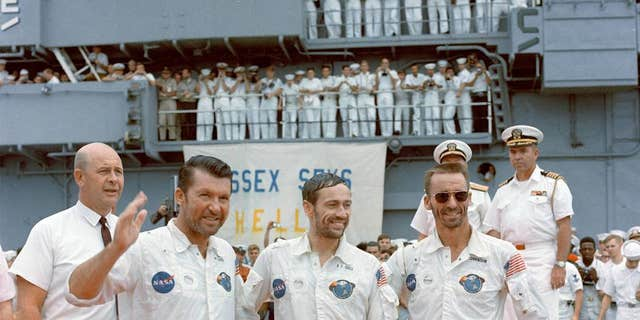 The Apollo 7 crew is welcomed aboard the USS Essex, the prime recovery ship for the mission, on Oct. 22, 1968. Left to right, are astronauts Walter M. Schirra Jr., commander; Donn F. Eisele, command module pilot; and, Walter Cunningham, lunar module pilot.