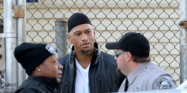 Former Carolina Panthers NFL football player Rae Carruth, center, exits the Sampson Correctional Institution in Clinton, N.C.