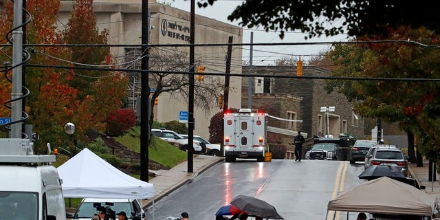 Media tents and vehicles line an intersection near the Tree of Life Synagogue, upper left, where a shooter opened fire Saturday.