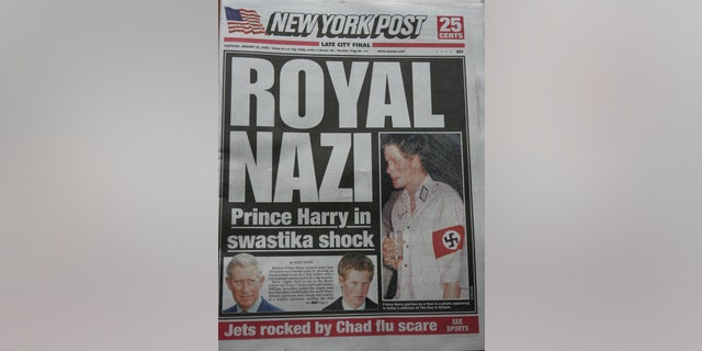 "A copy of The New York Post front page lies on display featuring a ""Royal Nazi"" headline Jan. 13, 2005 in New York City. The British royal, Prince Harry, reportedly attended a fancy dress party wearing a khaki uniform with an armband emblazoned with a swastika, the emblem of the German WWII Nazi Party. (Stephen Chernin/Getty Images)"