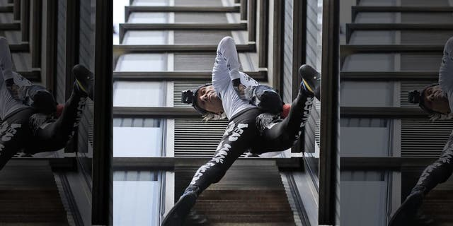 Urban climber Alain Robert, dubbed the French Spider-Man, scales the outside of Heron Tower building in London.