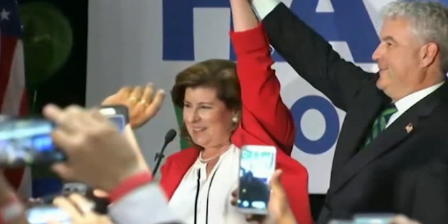 Karen Handel celebrates her narrow victory over Democratic opponent Jon Ossoff in a June 2017 special election.