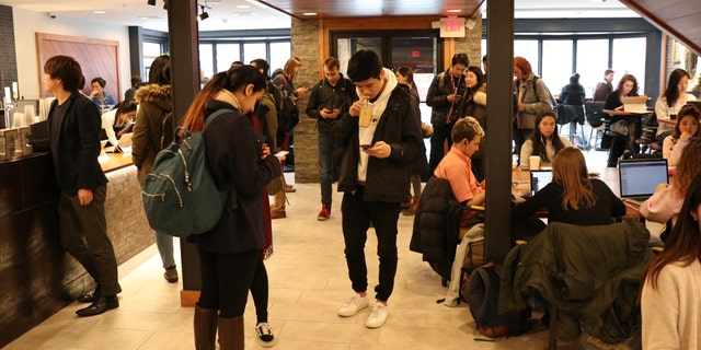Brown University students at Shiru Cafe, the first location to open in the United States.