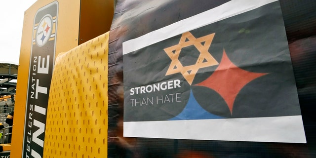 A Pittsburgh Steelers logo with one of the hypocycloids changed to a Star of David, on a banner at Heinz Field for Sunday's game between the Pittsburgh Steelers and the Cleveland Browns. (AP Photo/Gene J. Puskar)