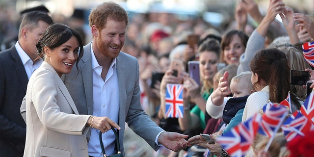 Britain's Prince Harry and Meghan, the Duchess of Sussex greet well wishers during their visit to Chichester, south east England, Wednesday Oct. 3, 2018. The Duke and Duchess of Sussex made their first joint official visit to Sussex. (Daniel Leal-Olivas/Pool via AP)