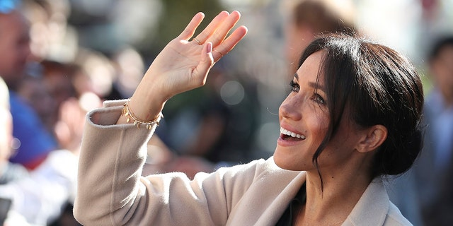 Britain's Meghan, the Duchess of Sussex greets well wishers as she and Prince Harry visit Chichester, south east England, Wednesday Oct. 3, 2018. The Duke and Duchess of Sussex made their first joint official visit to Sussex. (Daniel Leal-Olivas/Pool via AP)