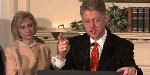 "President Bill Clinton shakes his finger as he denies improper behavior with Monica Lewinsky, in the White House Roosevelt Room. ""I did not have sexual relations with that woman,"" Clinton said. First Lady Hillary Rodham Clinton stands by her man."