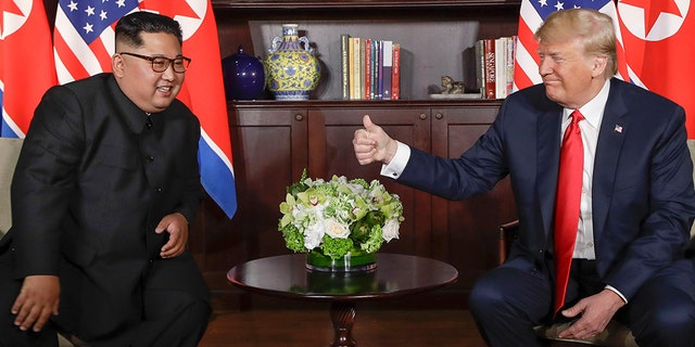 President Trump gives the North Korean leader Kim Jong Un at their meeting at Capella Resort on the Sentosa Island Tuesday, June 12, 2018 in Singapore a thumbs up.