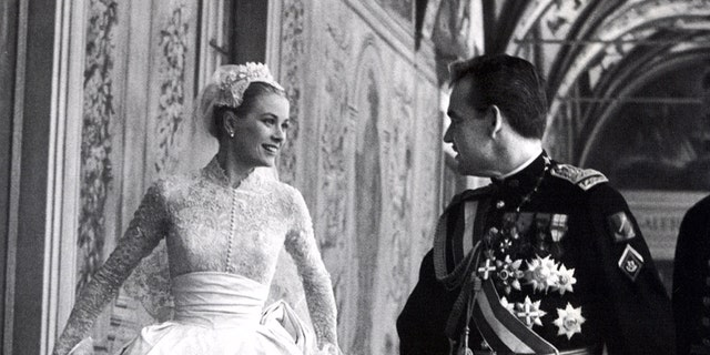 Princess Grace Kelly with Rainier III, Prince of Monaco on their wedding day.