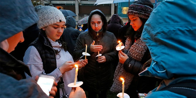 Holding candles, a group of girls wait for the start of a memorial vigil at the intersection of Murray Ave. and Forbes Ave. in the Squirrel Hill section of Pittsburgh, for the victims of the shooting at the Tree of Life Synagogue where a shooter opened fire, killing multiple people and wounding others, including sevearl police officers.