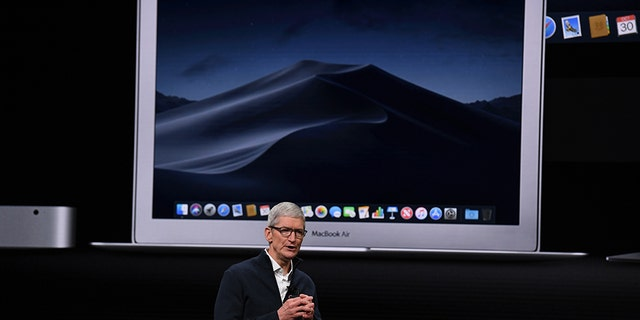 Apple CEO Tim Cook presents new products, including new Macbook laptops, during a special event at the Brooklyn Academy of Music, Howard Gilman Opera House October 30, 2018, in New York. (Photo by TIMOTHY A. CLARY / AFP) (Photo credit should read TIMOTHY A. CLARY/AFP/Getty Images)