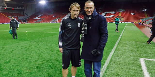 Terry Nelson poses with Real Madrid soccer star Luka Modric; Madrid are one of the European soccer teams who have used the suits