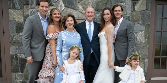Top row from l-r: Henry Hager, Jenna Bush, Laura Bush, George W. Bush, Barbara Bush, Craig Coyne, Barbara Bush and Craig Coyne and on the bottom, Margaret Hager and Poppy Louise Hager at Barbara and Craig's wedding on October 7.