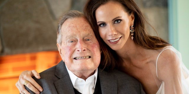 Former president George H. W. Bush and his granddaughter Barbara Bush at her Oct. 7 wedding