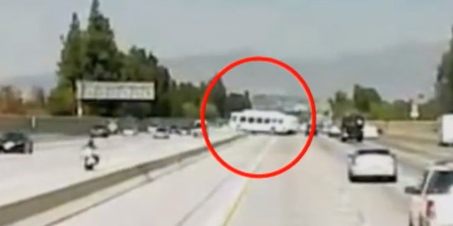 The bus can be seen slamming into the concrete divider on the 405 Freeway on Sunday.