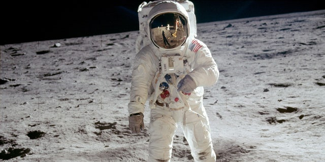 Buzz Aldrin, and Neil Armstrong reflected in his helmet, during the moon landing in 1969.
