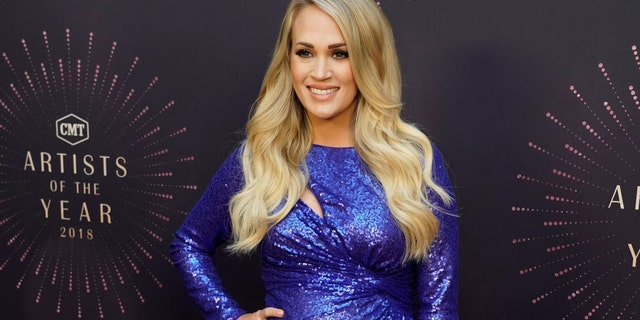 Carrie Underwood arrives at the 2018 CMT Artists of the Year show on Oct. 17, 2018, in Nashville, Tenn.