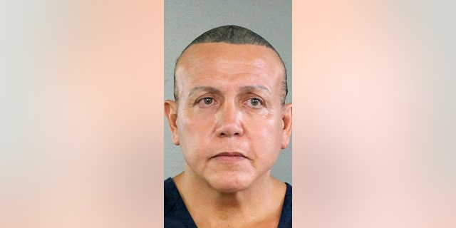 In this undated photo released by the Broward County Sheriff's office, Cesar Sayoc is seen in a booking photo, in Miami. Federal authorities took Sayoc, 56, of Aventura, Fla., into custody Friday, Oct. 26.