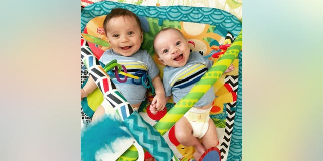 Cam, pictured with his twin brother, faces two more surgeries in his future.