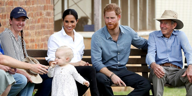 Britain's Prince Harry and Meghan, Duchess of Sussex sit down with the Woodleys during a farm visit in Dubbo, Australia, Wednesday, Oct. 17, 2018. Harry and Meghan are on day two of their 16-day tour of Australia and the South Pacific. (Chris Jackson/Pool via AP)