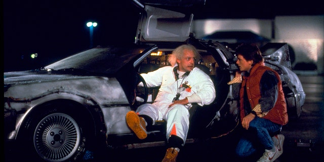 "Christopher Lloyd, left, as Dr. Emmett Brown, and Michael J. Fox as Marty McFly in the 1985 film, ""Back to the Future."" (Universal Pictures Home Entertainment via AP)"