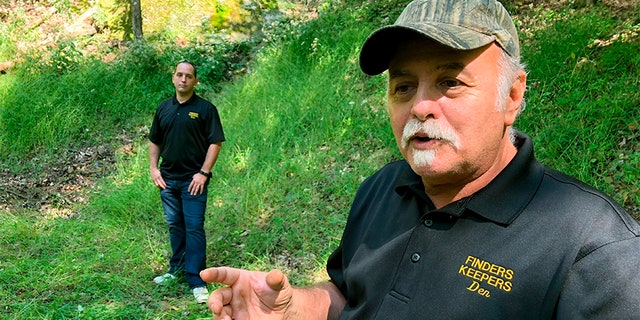 Dennis Parada, right, and his son Kem Parada stand in September at the site where the FBI dug for Civil War-era gold in March.