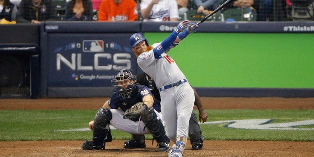Los Angeles Dodgers' Justin Turner (10) hits a two-run home run during the eighth inning of Game 2 of the National League Championship Series baseball game against the Milwaukee Brewers Saturday, Oct. 13, 2018, in Milwaukee.